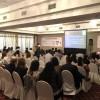Dra. Claudia Valencia delivering a talk in San Salvador