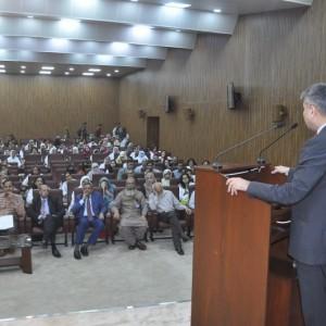 Dr. Tipu Sultan addressing audience at the scientific symposium